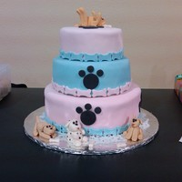 Puppy Theme Cake  Three tier cake, covered in fondant for my niece's tenth birthday. The little dogs were made in advanced with fondant. Very fun to get...