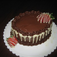 Chocolate And Strawberries chocolate fudge cake with real strawberries layered with chocolate frosting and white chocolate drippings! TFL!!!