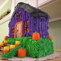 Halloween House Made for our neighborhood Meet N Greet on Halloween afternoon. I used the Wilton Standing House Pan. I thought it looked pretty cool.