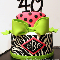 Zebra Cake With Pink & Lime Accents  Zebra with pink & green accents. Made to match party invitations. The client wanted black polka dots instead of multi-colored (as on...
