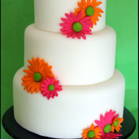 "Simple Gerber Daisy Cake  3 tier 6"", 8"" & 10"" dummies. I wanted to try out my new daisy cutters, and I wanted something simple, very clean. Happy..."