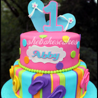 Flop Flop 1St Birthday Cake  This was such a fun cake to make! 1st Birthday party was flip-flop themed, with bright colors...pink, aqua, orange, etc. There was also a...