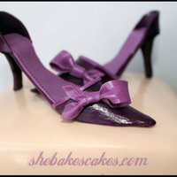 Birthday Shoes Cake!  This cake was made for my best friend's birthday. She is a shoe fanatic and loves the color purple! This was my 1st time making...