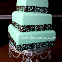 "Aqua And Brown Wedding Cake 6"", 8"" & 10"" squares. Mermaid green (greenish blue) with brown floral boarder. This cake is incredibly difficult to..."