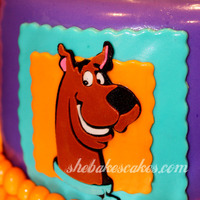 Scooby Doo Birthday Cake  2 tier Scooby Doo cake. Colorful Scooby plaques surround the bottom tier, and a 3D Scooby Doo collar tops it off. This was for a little boy...