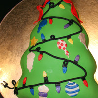 Christmas Tree, Unplugged ;) 2 layer dark chocolate fudge cake, chocolate BC, covered in vanilla fondant. Ribbon, lights, ornaments & cord/plug are all fondant....