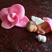 Angel Baby Little Angel Baby fell asleep under a rose pedle.