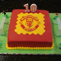 "Manchester United Football Club A birthday cake for my friend's 10 year-old son who is a Manchester United Fan. A 10"" square devil's food cake with..."