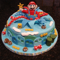 Supermario Land Cake This was a devil's food cake with Bunnywoman's chocolate buttercream filling, torted once only. The decorations are totally...