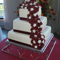"Three-Tier Square Wedding Cake With Burgundy Roses This was my first (and last) wedding cake! It was a 14"", 10"" and 8"" vanilla sponge torted twice each layer with strawberry..."