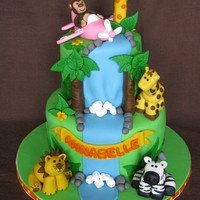 Jungle Babies 1St Birthday Cake  I was able let my creativity loose on this cake! It was made for a friends daughters first birthday. All her party goods were centered...