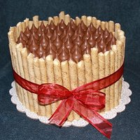 "Barrel Cake   8"" French vanilla with caramel icing, French Vanilla Pirouette cookies and caramel-filled Hershey Kisses."