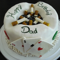 Ashtray Cake This is a cake i made for my dads 60th birthday. He has been a smoker since i was little and he loves to gamble. Those cigarettes are made...