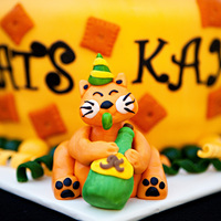 Party Cat This is a Cat named Cheez-it. He is made out of fondant. They wanted him celebrating the graduation with Cheez-its surrounding the cake....