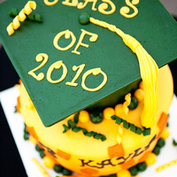 Graduation Cake With Cheez-Its And A Cat ;) These aren't call custom cakes for nothin!! This was for a Cal Poly Grad who had a cat named Cheez-it, so they wanted the cat and...
