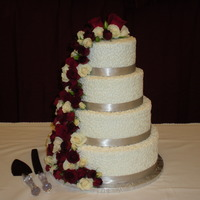 Simple Wedding  This was my first wedding cake- it was for a friend on a budget, so the flowers are from the florist. Simple white on white cornelli. BC...