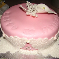 Pink Cake banana cake with strawberry flavor fondant, buterfly was pastillage and the calla lilly also pastillage