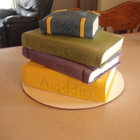 "Stack Of Books This cake is the equivalant of a quarter sheet cake plus about half of a 9"" round that I cut into 4 rectangles. It is frosted with..."