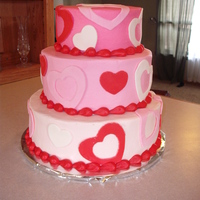 Valentine's Tiered Cake Three tired, buttercream with mmf heart cut outs.