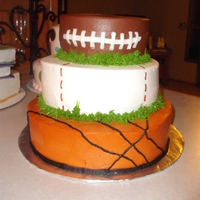 Sports Cake This cake was done for a baby shower for two ladies who were both having boys. The bottom two tiers are covered in vanilla buttercream and...