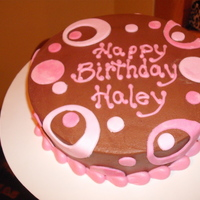 Pinkand Brown Polka Dots Chocolate cake, frosted with chocolate buttercream. MMF dots.