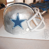 "Dallas Cowboys Helmet Made using two 9""round cake pans and a dome pan. Frosted with buttercream. Grill is made half mmf, half gumpaste."