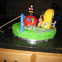 Mickey Mouse Club House cake for my son's 4th birthday. was unsuccessful in making a mickey mouse head to go on top - tried many different things!