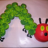 The Hungry Caterpillar Head is a cake and the body is cupcakes.