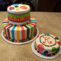 Reid's First Birthday Tiered cake with dots and stripes. Smash cake to match!