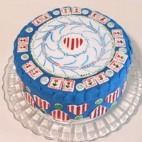 American Quilt Cake This is an 8 inch cake covered in blue fondant with an airbrushed center plaque, with some handpainted details. I wanted to do an American...