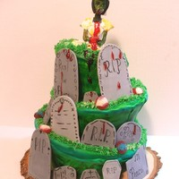 Zombie Bride Cake this is a topsy turvy cake that I did with a zombie bride theme. Its pound cake and vanilla buttercream covered in fondant. The figure and...