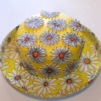 White And Orange Mod Daisies On A Yellow Cake I was inspired to make this cake because of the vinage cake plate that I found. The cake is 8 inches by 4 inches, covered in fondant and is...