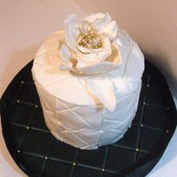 Black And White Quilted Cake I made a cake for my aunts birthday that was black and white and quilted. The fantasy flower was very fun to make. I loved making the...
