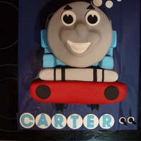 Thomas The Tank Banana cake with chocolate ganache covered in fondant! I followed the instructions from the website http://www.ehow.com/how_5335332_make-...