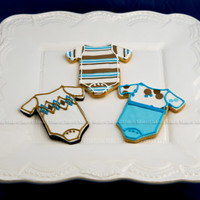 Baby Boy Chocolate & Vanilla Sugar Cookies with Fondant & Royal Icing accents... Stripes are extruded from Sugar Gun and rolled to 1/8&quot...