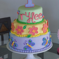 """rylee"" Inspired by the ""Hugs & Stitches"" theme/decor, this is a 6"" Round /8"" Petal/10"" Round cake. Top & Bottom..."