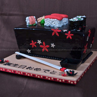 "Sushi Revisited 12""-10"" Tapered Rectangle, White Chocolate Cake with Raspberry SMBC, Black Satin Ice Fondant, Sushi pieces are cake with fondant..."