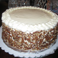 Italian Cream Cake Italian Cream Cake, Cream Cheese Icing with pecan crusted sides and rosette border