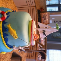 Ocean Theme Baby Shower Cake Fondant three tiered cake. I used chocolate/candy molds for the sea creatures and boat, but I used fondant instead of chocolate for all the...