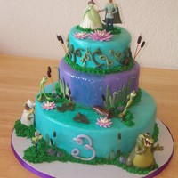 Lauryn's 3Rd Birthday Cake Princess and the frog themed cake, based on cakes I've seen on the internet and on here :) Everything is edible, except the figures.