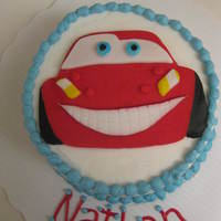 "Disney Cars Lightning Mcqueen Smash Cake 4"" round vanilla/vanilla buttercream cake. Car was freehanded on paper, then cut out to use as a template to cut fondant. Some details..."
