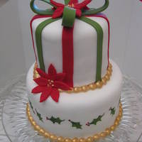 "Mini 2 Tier Christmas Cake 4"" & 6"" tiers covered in white fondant with fondant accents. Bottom layer is handpainted with Americolor gel food coloring...."