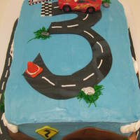 Disney Cars Cake Double layer 9x13 chocolate Oreo cake with Oreo buttercream filling. Blue vanilla buttercream on the outside. All decorations (except for...