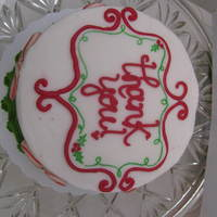 "Christmas ""thank You"" Cake 6"" cake I made for the photographer who took our family Christmas pictures. White peppermint cake with candy cane buttercream."