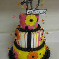 "40 & Fabulous Cake 3 tier (4""/6""/8"") dark chocolate cake with vanilla buttercream. Accents are fondant. The ""40"" on top is paper..."