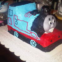 Thomas The Train.. I did this cake for my boyfriends nephew and carved it all on my own.. Wow what work... but so worth it....