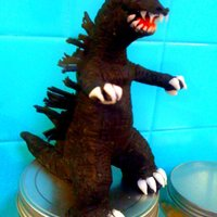 Godzilla Modeling Chocolate Figure I made this for my neighbor's son who was turning 13. Entirely handsculpted out of modeling chocolate.