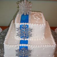 Winter Wedding This is all buttercream with plastic snowflae accents