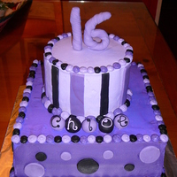 2 Tier Funky Purple This is a 10x10 square and 6 in round. Buttercream base icing with fondant accents.