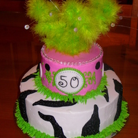 Funky Zebra This is a 10 and 8 in round with buttercream base icing. Fondant dots and feathers and bead sprays on top.